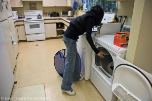 Doing laundry in the basement.